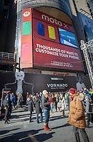 Advertising in Times Square in New York for the Moto X, the first smartphone from Motorola since it was acquired by Google, seen on Thursday, January 30, 2014. Google has sold Motorola Mobility to Lenovo for $2.91 billion. Google paid $12.5 billion less than two years ago to acquire Motorola. Google gets to keep billions of dollars worth of patents in the deal.  (© Richard B. Levine)