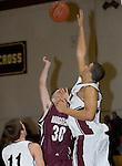 TORRINGTON, CT- 06 JANUARY 2009 --010609JS08-Torrington's Jordan Williams (20) blocks a shot by Naugatuck's Joe Iannotti (30) during their game Tuesday at Torrington. <br /> Jim Shannon / Republican-American