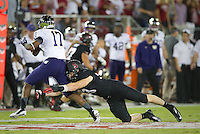 Stanford, California - Saturday, October 5, 2013: The Stanford football team defeated the University of Washington 31-28 at Stanford Stadium. Trent Murphy makes a tackle.