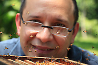 """Giorgio Venturieri in front of an open hive of Friseomelitta sp bees, which have the particularity of keeping on their back legs little balls of resin to protect them from ant attacks. """"I put in place a system of hives that allows for the colonies' easy division, to multiply the hives and carry out several honey harvests."""""""