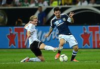 FUSSBALL Nationalmannschaft Freundschaftsspiel:  Deutschland - Argentinien             15.08.2012 Andre Schuerrle (li, Deutschland)  gegen Lionel Messi (Argentinien)
