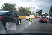Street Vendors in traffic in the Circuito.  Mexico City