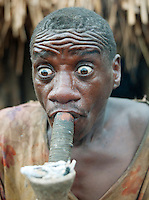 A village elder from a Batwa tribe smokes from a traditional pipe. The Batwa are a pygmy people who were the oldest recorded inhabitants of the Great Lakes region of central Africa. South West Uganda