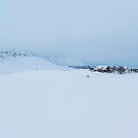 Farm building in snowy winter landscape, Farstad, Vestvågøy, Lofoten Islands, Norway