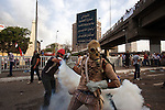 A mix of Salafi and revolutionary youth activists battle Egyptian security forces, lobbing back tear gas canisters that have been fired at them during May 4, 2012 demonstrations against the ruling Supreme Council of the Armed Forces (SCAF) near the Defense ministry building in the Abbasiya district of Cairo. Close to 300 people were injured in the clashes, one killed, and an estimated 300 people arrested by the military.