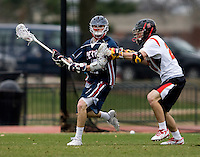 Scott LaRue (20) of Maryland tries to hold off Corey Winkoff (42) of Penn at Ludwig Field in College Park, Maryland.