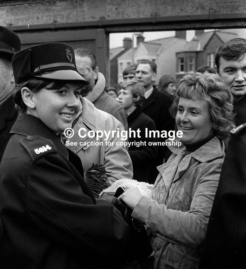 New Zealand All Blacks meet Ulster at Ravenhill, Belfast, N Ireland, 18th November 1972. The All Blacks won 16-9. The game was played at the height of The Troubles in N Ireland and security was very much in evidence. A policewoman checks a woman&rsquo;s handbag. 197211180739a<br /> <br /> Copyright Image from Victor Patterson, 54 Dorchester Park, Belfast, UK, BT9 6RJ<br /> <br /> t1: +44 28 9066 1296 (from Rep of Ireland 048 9066 1296)<br /> t2: +44 28 9002 2446 (from Rep of Ireland 048 9002 2446)<br /> m: +44 7802 353836<br /> <br /> e1: victorpatterson@me.com<br /> e2: victorpatterson@gmail.com<br /> <br /> The use of my copyright images is subject to my Terms &amp; Conditions.<br /> <br /> It is IMPORTANT that you familiarise yourself with them. They are available on my website at www.victorpatterson.com.<br /> <br /> None of my copyright images may be used on a website unless they are visibly watermarked, i.e. &copy; Victor Patterson within the body of the visible image. Metadata denoting my copyright must NOT be deleted. <br /> <br /> Web use is extra at currently recommended NUJ rates.