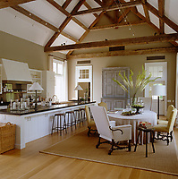 The double height ceiling results in the light and airy atmosphere in the kitchen/dining area