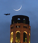 The crescent moon setting behind Coit Tower as seen from Pier 27, San Francisco, CA.