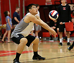 Cheshire, CT- 18 May 2017-051817CM09-  <br /> Cheshire's Jeff Tang  bumps the ball during their SCC volleyball matchup against Xavier on Thursday.  Christopher Massa Republican-American