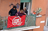 Rome, Italy. 16th February 2016<br /> Riot police breaks through the door of the building where he lives Mrs. Ida (C) with her husband who have barricaded themselves in the house to resist to eviction, to Centocelle district. The picket anti-eviction seeks to block the eviction.