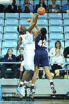 14 November 2012: North Carolina's Waltiea Rolle (32) blocks a shot by Georgetown's Vanessa Moore (42). The University of North Carolina Tar Heels played the Georgetown University Hoyas at Carmichael Arena in Chapel Hill, North Carolina in an NCAA Division I Women's Basketball game, and a semifinal in the Preseason WNIT. UNC won the game 63-48.