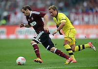 FUSSBALL   1. BUNDESLIGA  SAISON 2012/2013   2. Spieltag 1. FC Nuernberg - Borussia Dortmund       01.09.2012 Mario Goetze (re, Borussia Dortmund) gegen Javier Pinola  (1 FC Nuernberg)