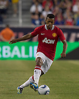 Manchester United FC midfielder Nani (17) brings the ball forward. In a Herbalife World Football Challenge 2011 friendly match, Manchester United FC defeated the New England Revolution, 4-1, at Gillette Stadium on July 13, 2011.