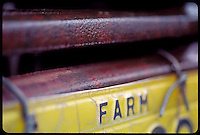 CLOSE UP OF THE WORD FARM ON A WISCONSIN FARM LICENSE PLATE.