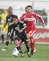 Andy Najar #14 of D.C. United breaks away from Peter Lowry #8 of the Chicago Fire during an MLS match on April 17 2010, at RFK Stadium in Washington D.C. Fire won the match 2-0.