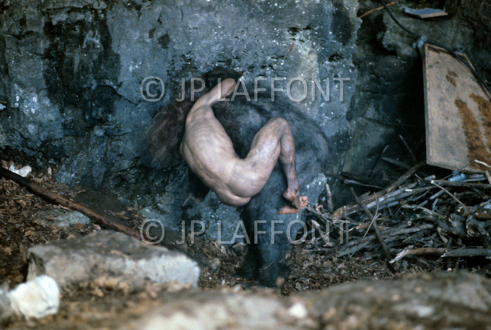"""Toronto area, Canada.1981. 80,000 years ago, the tribe who posessed fire, posessed life. A primitive tribe try to keep a natural fire source for survival.  This part of the movie was filmed in Canada.  """"Quest for Fire"""" (La guerre du feu) by French director Jean-Jacques Annaud, and based on the novel of JH Rosny. Scene of the tribe under attack, trying to keep their fire."""