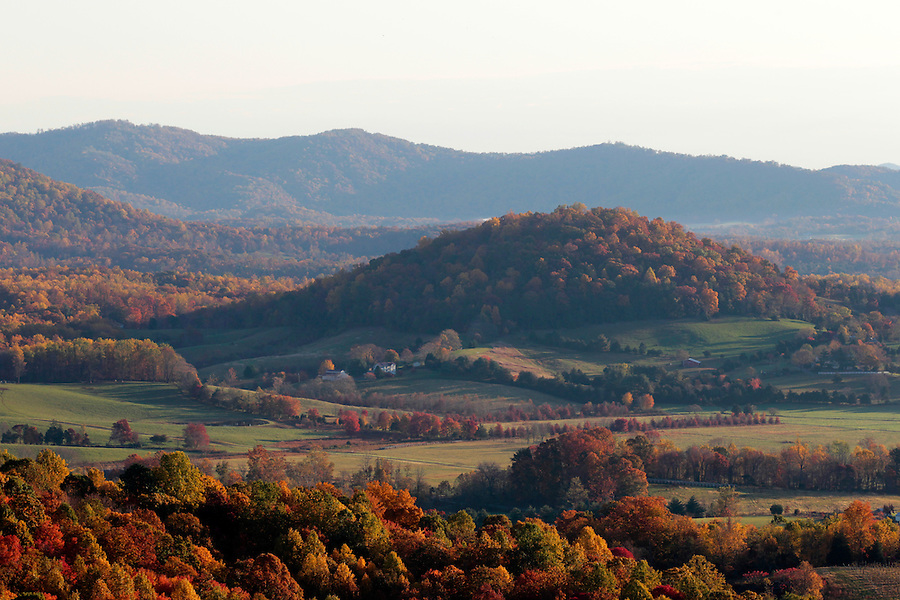 A stunning mountain view filled with fall colors  in the valley from Turkey Ridge in Greene County, VA.  Photo/Andrew Shurtleff
