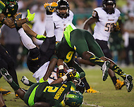 Tampa, FL - September 4th, 2016: Towson Tigers wide receiver Dillon Tighe (13) is hit by South Florida Bulls defensive back Lamar Robbins (6) and South Florida Bulls cornerback Armunz Mathews (2) during a punt return against USF at Raymond James Stadium in Tampa, FL.  (Photo by Phil Peters/Media Images International)