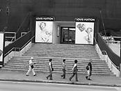 Japanese tourists walk past Louis Vuitton store in Tumon, Guam, on Saturday, Mar. 10, 2007.  Sometimes known as 'America in Asia', Guam is a popular destination for Japanese tourists ( accounting for approx 90% of the island's visitors) with average visitor numbers from Japan approaching 1million.  The island, a 3.5 hour flight from Japan, has more than 20 large hotels and numerous duty-free shopping malls catering to the Japanese tourists predilection for designer brand name goods, as well as golfing and other water based entertainment features. In 2007-2008 US military personal currently stationed in the Japanese Okinawan Islands will relocate their bases and operations  to Guam, helping to stabilise the island's economy which suffered after tourism decreased in recent years due to a  fear of flying by Japanese post 9-11 World Trade Centre disaster, a 2003 typhoon and the SARS disease outbreak in Asia.