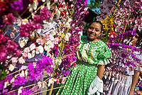 "Salvadoran girls carry palm branches with colorful flower blooms during the procession of the Flower & Palm Festival in Panchimalco, El Salvador, 8 May 2011. On the first Sunday of May, the small town of Panchimalco, lying close to San Salvador, celebrates its two patron saints with a spectacular festivity, known as ""Fiesta de las Flores y Palmas"". The origin of this event comes from pre-Columbian Maya culture and used to commemorate the start of the rainy season. Women strip the palm branches and skewer flower blooms on them to create large colorful decoration. In the afternoon procession, lead by a male dance group performing a religious dance-drama inspired by the Spanish Reconquest, large altars adorned with flowers are slowly carried by women, dressed in typical costumes, through the steep streets of the town."