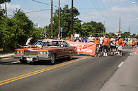 AUSTIN, TEXAS - A vintage cadillac painted in &ldquo;burnt orange&rdquo; with longhorns mounted on the hood drives along the University of Texas Athletics Department at the 2016 Central Texas Juneteenth Celebration Parade on on Sat. June 18, 2016. <br />