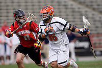 Brian Carroll (36) of Virginia moves in on Bryn Holmes (17) of Maryland during the ACC men's lacrosse tournament finals in College Park, MD.  Virginia defeated Maryland, 10-6.