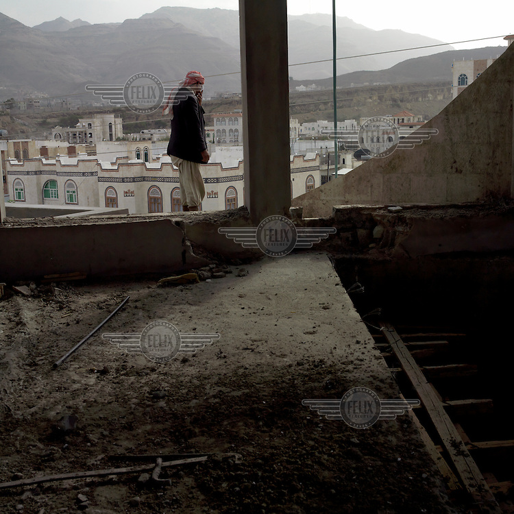 Construction worker at a site to build a mansion in the new town..