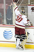 Chris Venti (BC - 30) passes a puck to a young fan through a gap in the glass. - The Boston College Eagles defeated the visiting University of Maine Black Bears 4-1 on Sunday, November 21, 2010, at Conte Forum in Chestnut Hill, Massachusetts.