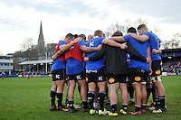 The Bath Rugby forwards huddle together during the pre-match warm-up. European Rugby Champions Cup match, between Bath Rugby and RC Toulon on January 23, 2016 at the Recreation Ground in Bath, England. Photo by: Patrick Khachfe / Onside Images