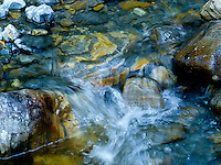 Flowing water down a small creek in the Jewel Basin in Montana