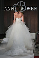 Model walks runway in an Argent wedding dress by Anne Bowen, for the Anne Bowen Bridal Spring 2012 runway show.