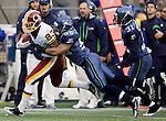 Washington Redskins wide receiver Fed Davis tries to run away from Seattle Seahawks linebacker Leroy Hill after catching pass at  CenturyLink Field in Seattle, Washington on November 27, 2011. . ©2011 Jim Bryant Photo. All Rights Reserved.