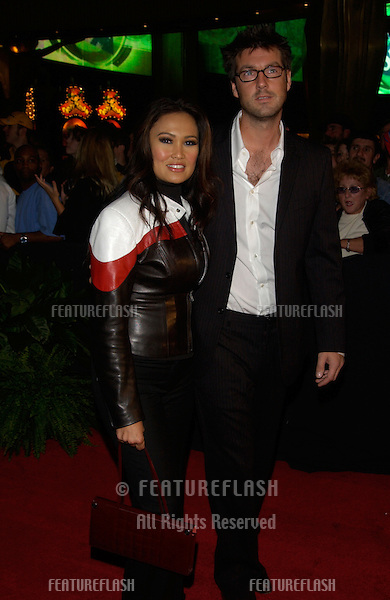 Actress TIA CARRERRE & husband at the 2002 Fox Billboard Bash in Las Vegas. The party is the pre-event for the Billboard Music Awards..08DEC2002.  © Paul Smith / Featureflash