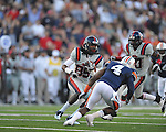 Ole Miss Ja-Mes Logan (85) runs against Auburn strong safety Zac Etheridge (4) at Vaught-Hemingway Stadium in Oxford, Miss. on Saturday, October 30, 2010. Auburn won 51-31.