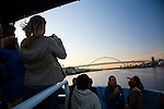 National Geographic Sea Lion's trip departing from Portland, Oregon, through the bridges and heading out towards Astoria, Oregon. Passengers enjoying the sunset on the Willamette River as we pass under the Broadway Bridge and head towards the Fremont Bridge.