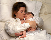 Mother in bed with her newborn boy.