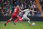"""Luka Modric (r) of Real Madrid battles for the ball with Victor Machin Perez """"Vitolo"""" of Sevilla FC during their Copa del Rey Round of 16 match between Real Madrid and Sevilla FC at the Santiago Bernabeu Stadium on 04 January 2017 in Madrid, Spain. Photo by Diego Gonzalez Souto / Power Sport Images"""