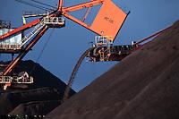 Mining, Brazilian commodity - conveyor belt, transportation of iron ore for exportation at Tubarao Harbour in Vitoria city, Espirito Santo State, Brazil.