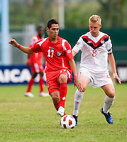 Bryce Alderson (8) of Canada keeps pressure on Bryan Santamaria (17) of Panama during the semifinals of the CONCACAF Men's Under 17 Championship at Catherine Hall Stadium in Montego Bay, Jamaica. Canada defeated Panama, 1-0.
