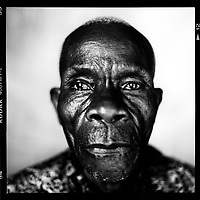 Longin Ngwadi: 'I went to Kinshasa in 1945. I was seventeen at the time. It was three or four days sailing with the post boat. I didn't know anyone when I arrived in Kinshasa, no one at all. A nightwatchman called me in to the property he had to look after. He was someone from my district. I was allowed to sleep on the ground there, in the open air. Shortly after that I got my first job in a general store. I had to sell trousers, shirts, soap, sugar, all kinds of things. I later sold sausages on the street until I was dismissed because I once sold someone some bad liver sausage. Eventually I had the opportunity to go and work as a waiter for the next-to-last governor-general of the Belgian Congo. Five of us had to present ourselves at the 'Maison des Blancs'. That was the place where all of Congo's secrets were kept. The white people met there to govern the Congo. Of the five, I was the most polite and most orderly, so I was allowed to become the governor's personal 'house boy'. I worked for him for four years. I was even able to go with him to Belgium during the world exhibition in Brussels in 1958, by aircraft. But I was unable to see the Atomium because I had to cook and wash in Namur, a city 60 kilometres from Brussels, all the time. I had a very good time in Belgium. I received many gifts there. I was told about the seaport and the trains that disappeared under the ground. Namur was an intelligent city, just like Kikwit.'.