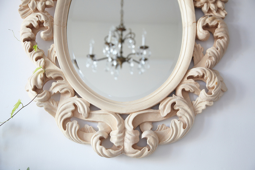 Mirror detail with chandelier and ivy