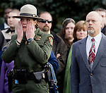 A National Park Service Ranger wipes away tears as the hearse carrying the casket of National Park Service Ranger Margaret Anderson arrives during a memorial service at the Pacific Lutheran University in Tacoma on January 10, 2010. Anderson was slain at Mount Rainier on New Years' Day when she set up a road block to intercept a vehicle, driven by Benjamin Barnes, who failed to stop at a chain-up checkpoint.  Barnes, the suspect  in the shooting was found dead was found dead the next day. He had drown in Paradise Creek.   ©2012. Jim Bryant Photo. All RIGHTS RESERVED.