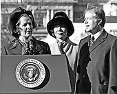 Washington, DC - (FILE) -- Prime Minister Margaret Thatcher of the United Kingdom, left, is shown as she spoke at the arrival ceremonies in her honor at the White House in Washington, D.C. on Monday,December 17, 1979. In her remarks she praised United States President Jimmy Carter's, right, handling of the Iran hostage crisis by saying he has gained respect around the world for his courage and patience.  First lady Roslyn Carter, center, looks on..Credit: Benjamin E. &quot;Gene&quot; Forte - CNP