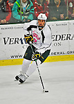 28 January 2012: University of Vermont Catamount defenseman Drew MacKenzie, a Senior from New Canaan, CT, initiates a rush against the Northeastern University Huskies at Gutterson Fieldhouse in Burlington, Vermont. The Catamounts, dressed in their Breast Cancer Awareness jerseys, fell to the Huskies 4-2 in the second game of their 2-game Hockey East weekend series. Mandatory Credit: Ed Wolfstein Photo