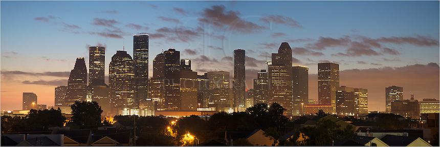About 20 minutes before sunrise, low clouds roll across the south Texas sky in this panoramic photo of downtown Houston. The skyline was beginning to awaken as the highrises and their lights began to fade. This view looks east.
