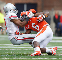 Ohio State Buckeyes safety C.J. Barnett (4) takes down Illinois Fighting Illini running back Josh Ferguson (6) in first quarter action at Memorial Stadium in Champaign, Illinois on November 16, 2013.  (Chris Russell/Dispatch Photo)