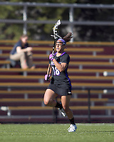 University at Albany midfielder Allie Phelan (18) advances the ball. University at Albany defeated Boston College, 11-10, at Newton Campus Field, on March 30, 2011.