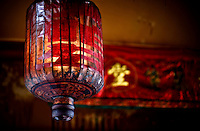 In ancient and traditional red Chinese lantern hangs in the temple in Penang, Malaysia. These old bamboo and paper lanterns are becoming less and less used as the makers of the lanterns are disappearing.