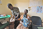 At the Presbyterian Church-sponsored Ekwendeni Hospital in northern Malawi, a woman grimaces as she gets a blood test for HIV.